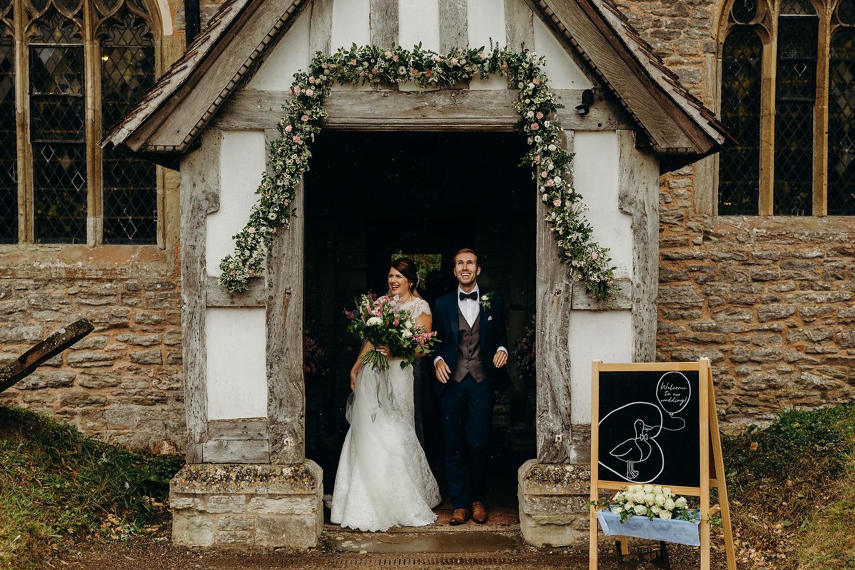 rain as couple leave church wedding