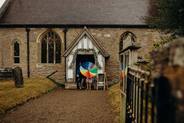 rain as guests leave church wedding