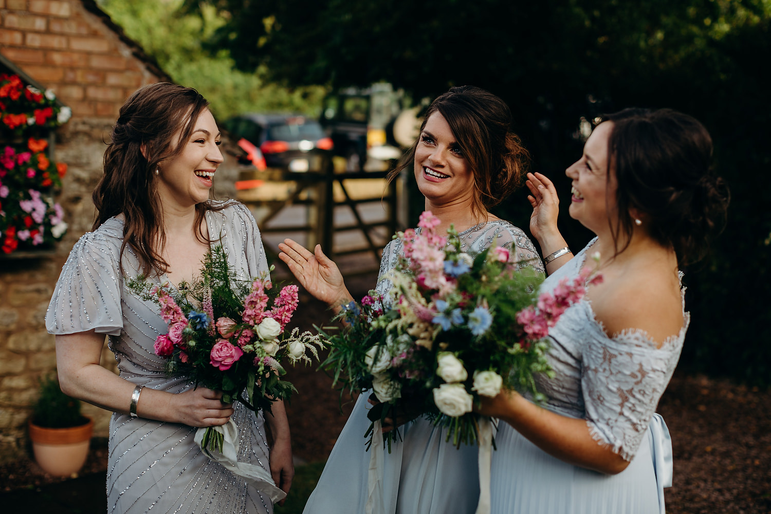 Bridesmaids laughing at garden marquee wedding