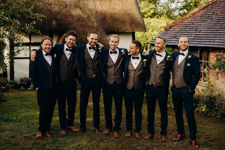 groom with ushers in garden