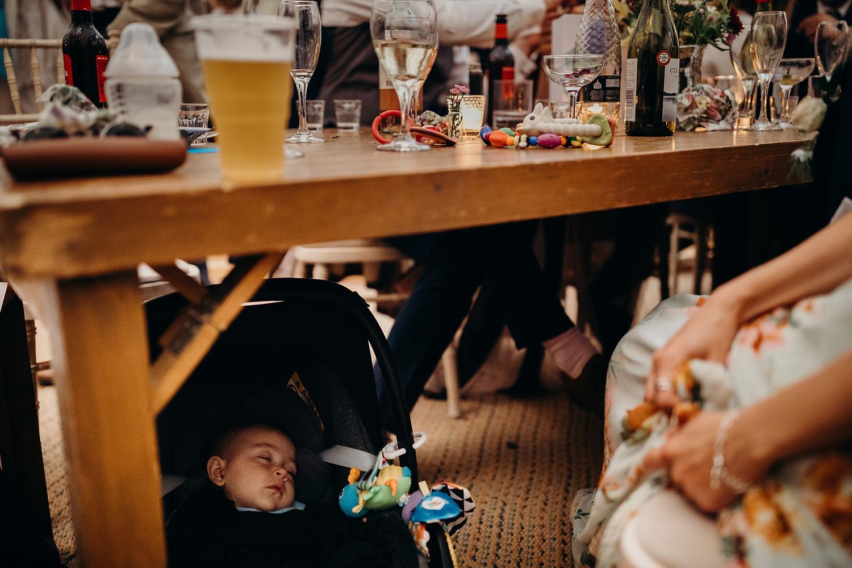 todler sleeping at wedding