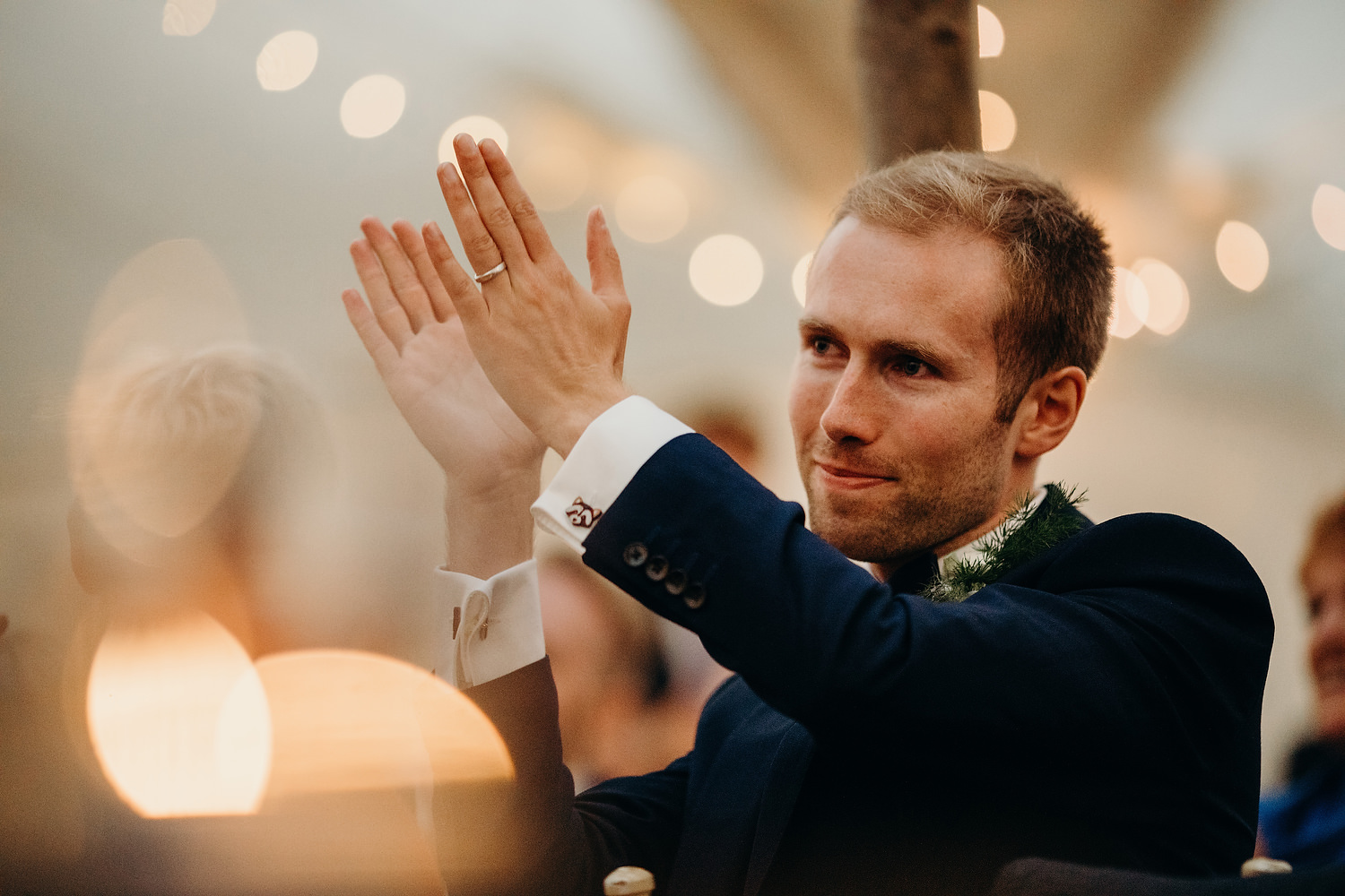 groom clapping to brides speech