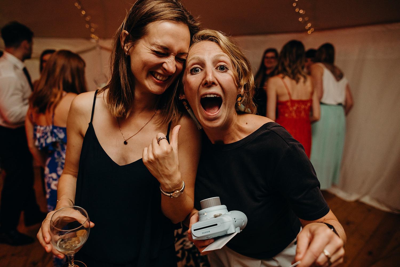 two woman smiling on dancefloor