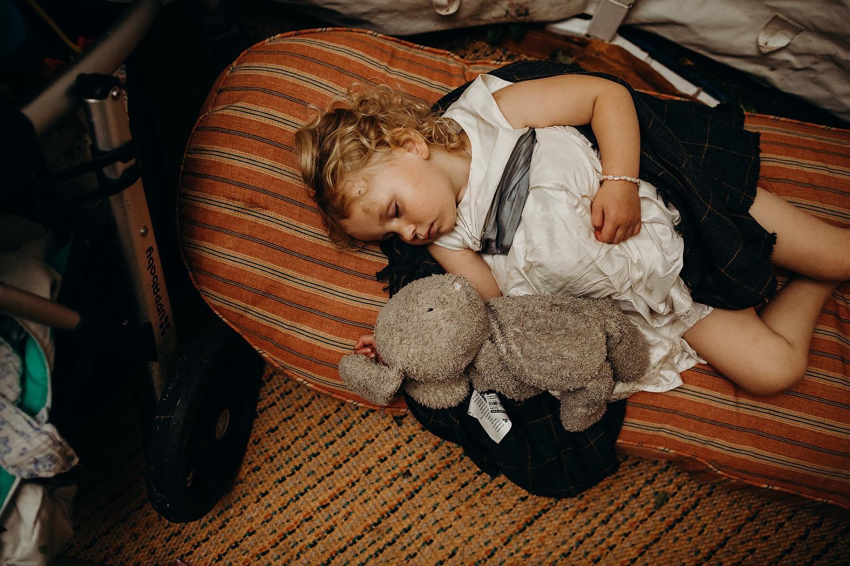 girl sleeps at wedding