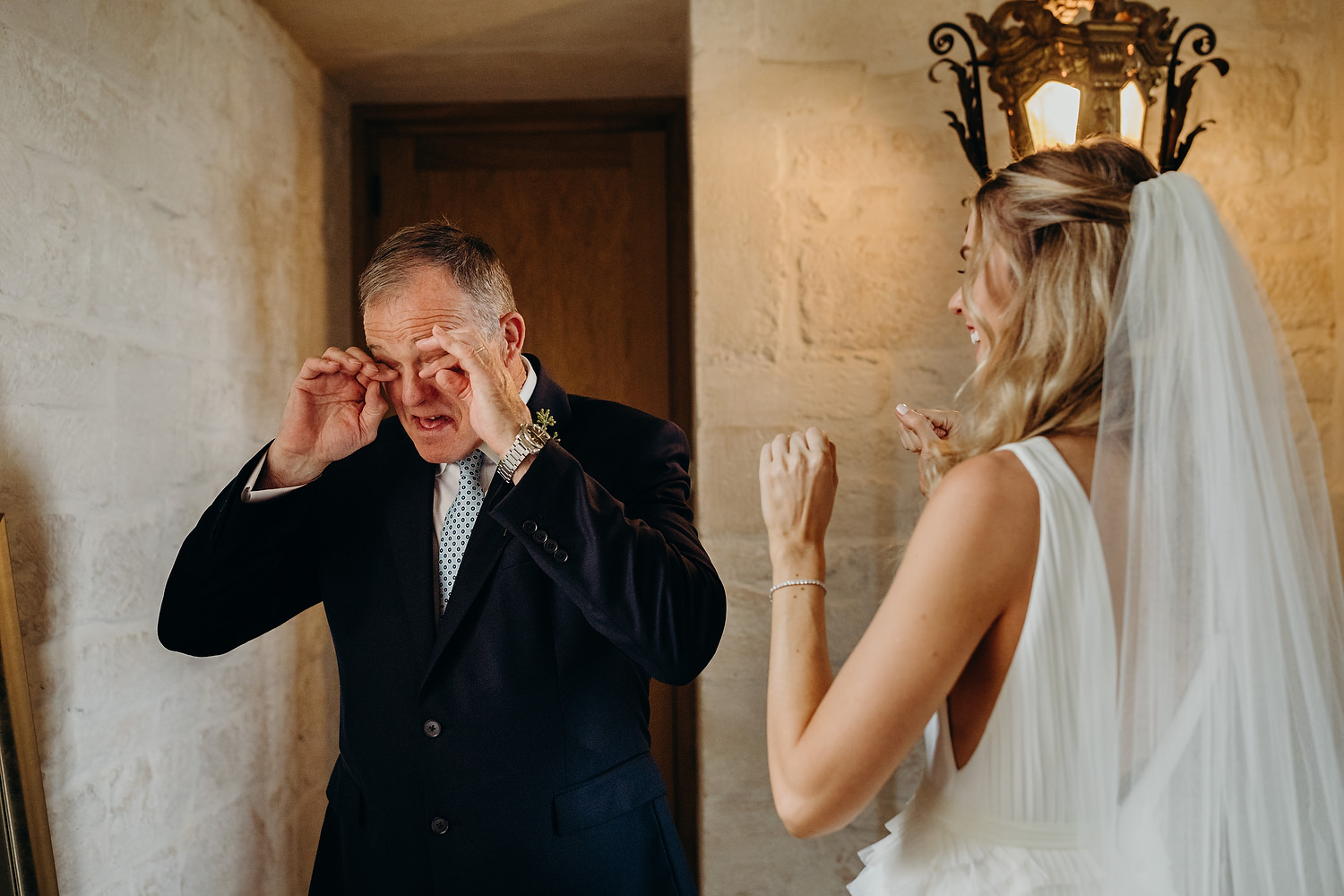 father of bride cries seeing daughter