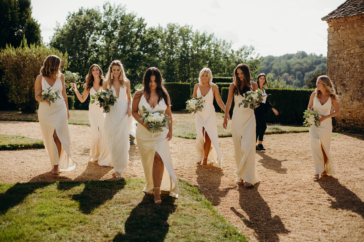 bride and friends walk for pictures
