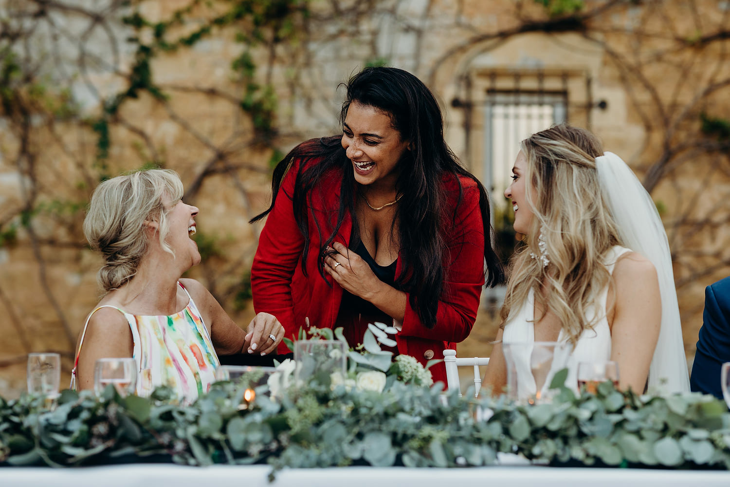 bride laughs with friends