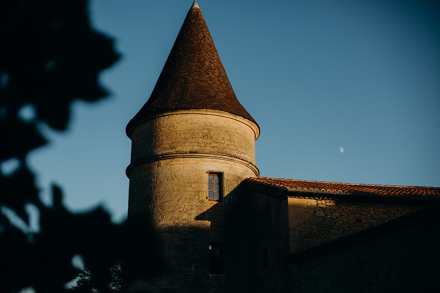 Chateau spire with moon in background