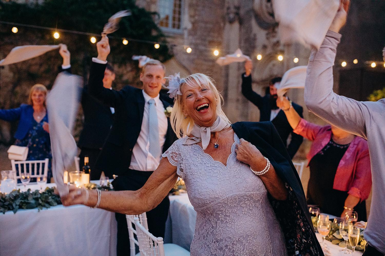 wedding guests waving napkins