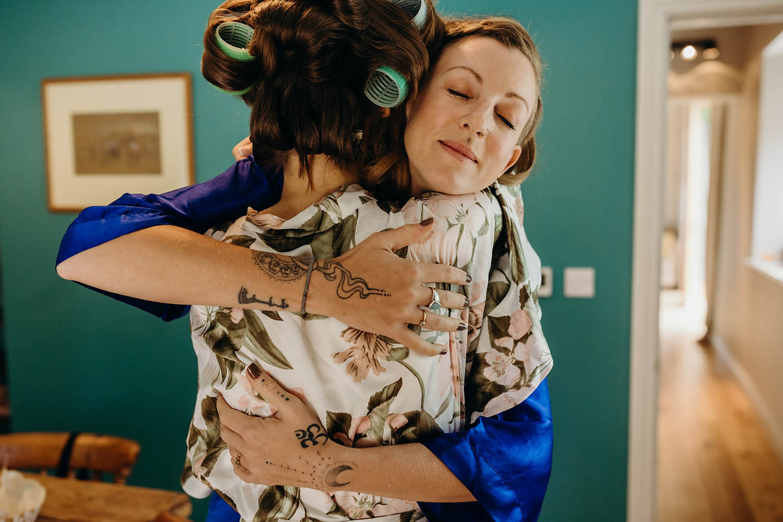 sister hugging bride
