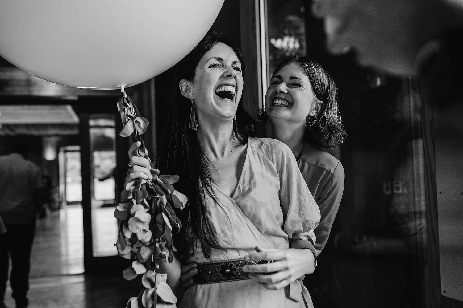 wedding guests laughing during reception