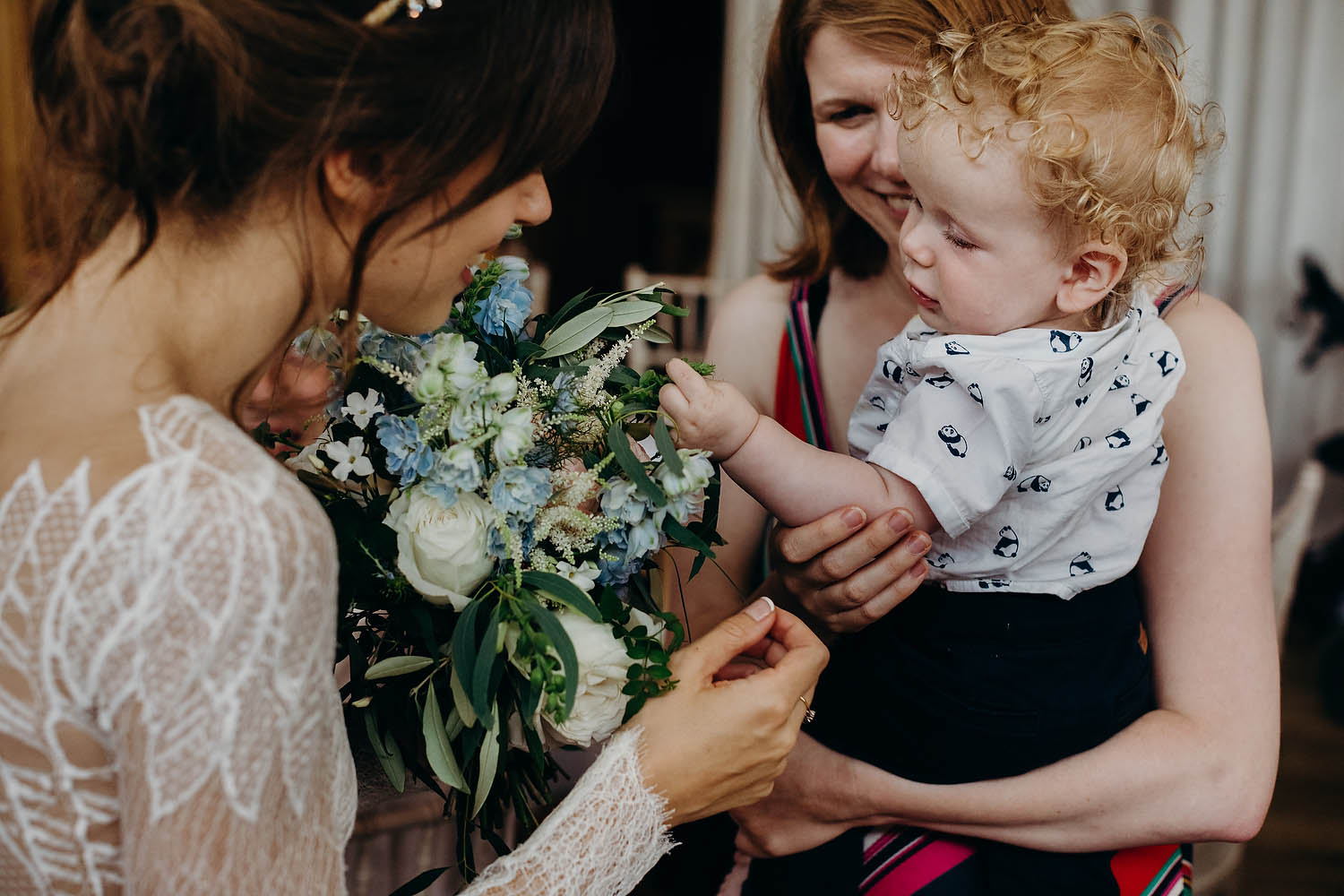 child plays with wedding bouquet