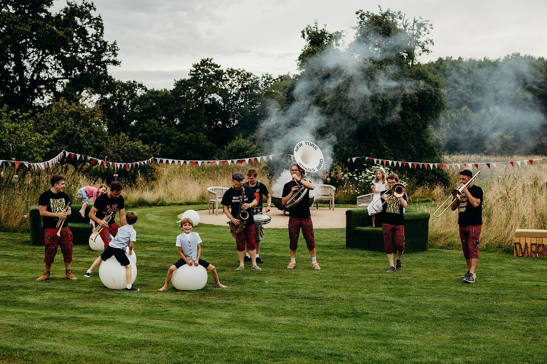 7-piece brass band play outdoor wedding