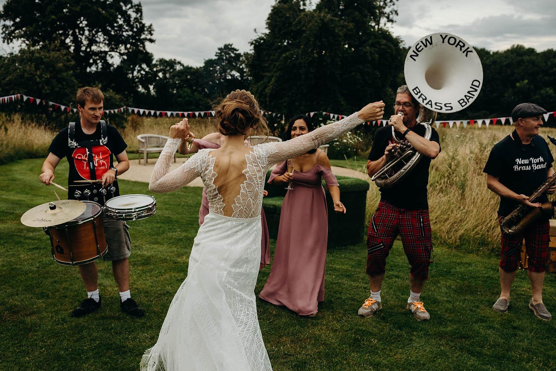 bride dancing in outdoor wedding reception