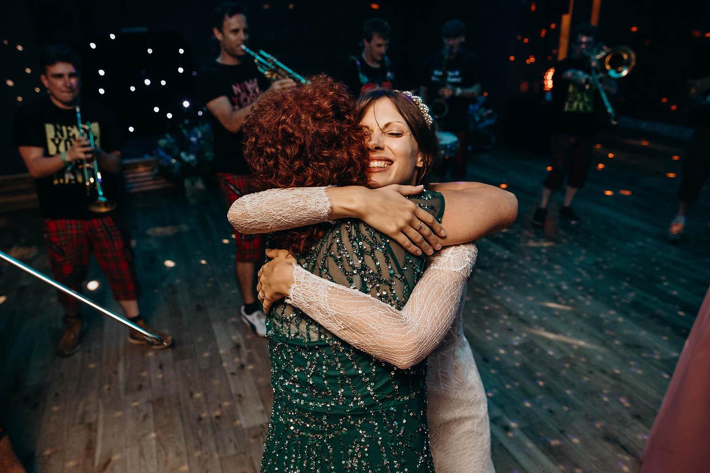 bride hugging at wedding