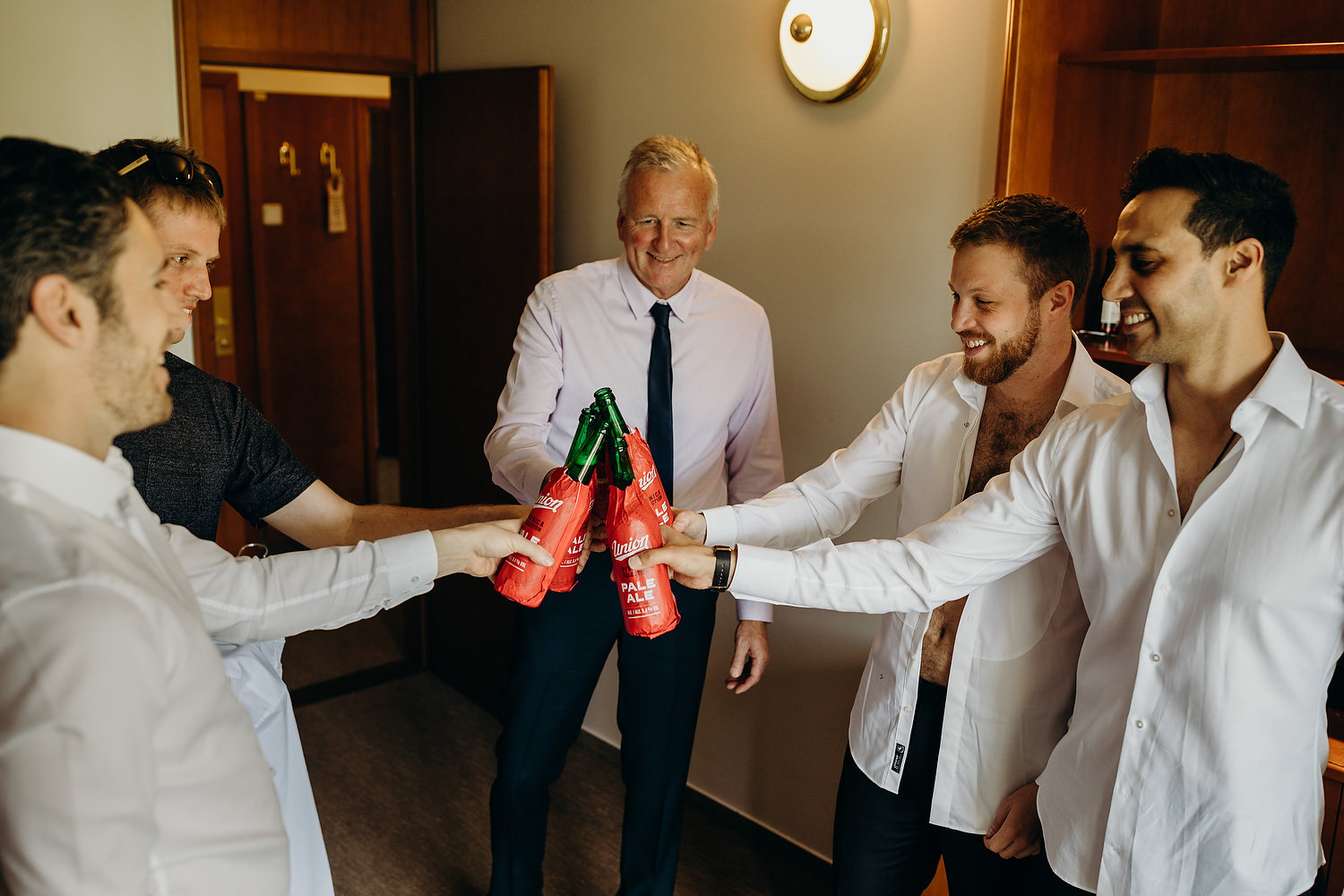 groom and ushers have a beer before ceremony