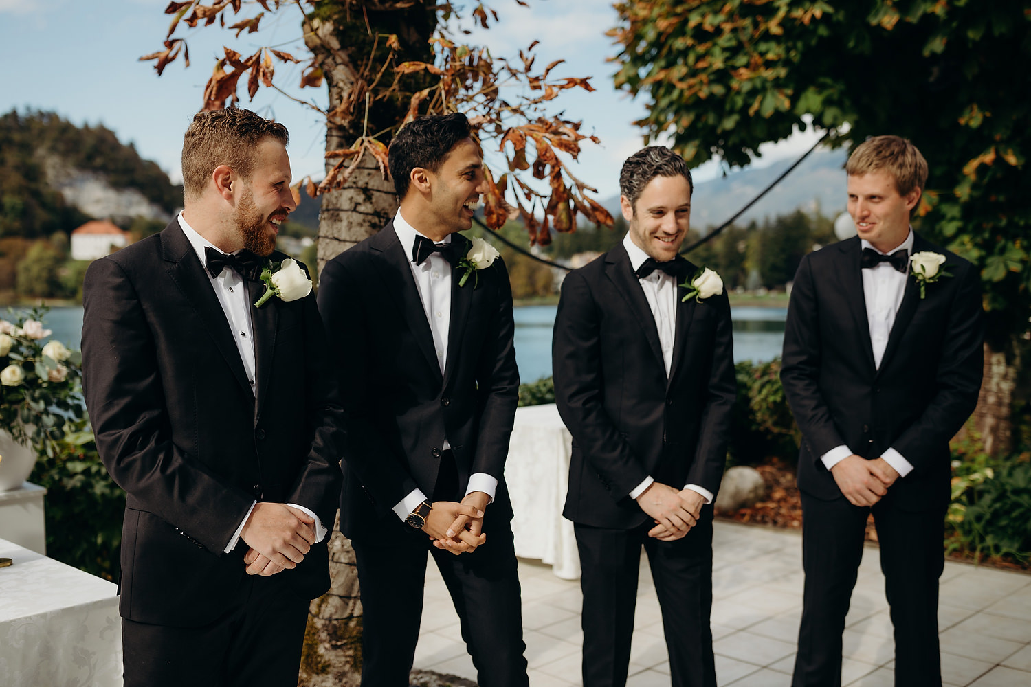groom and ushers laughing before ceremony