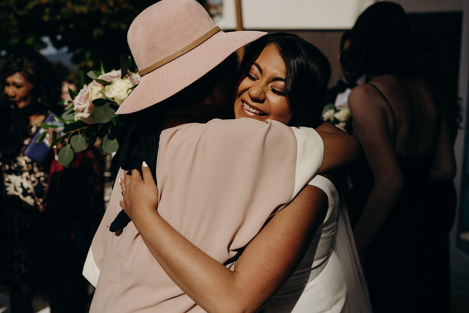 bride hugs grandmother