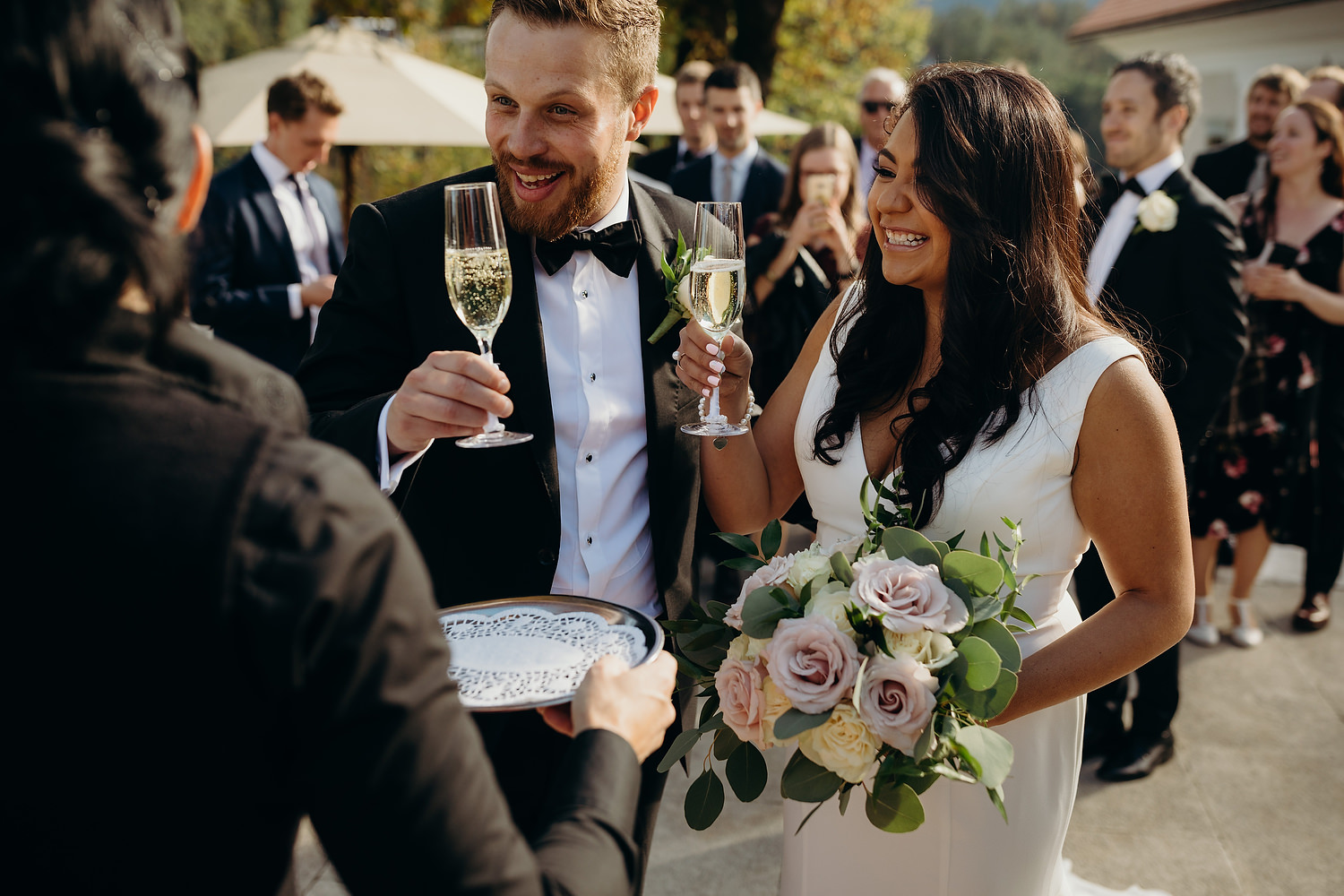 bride and groom get a glass of champagne