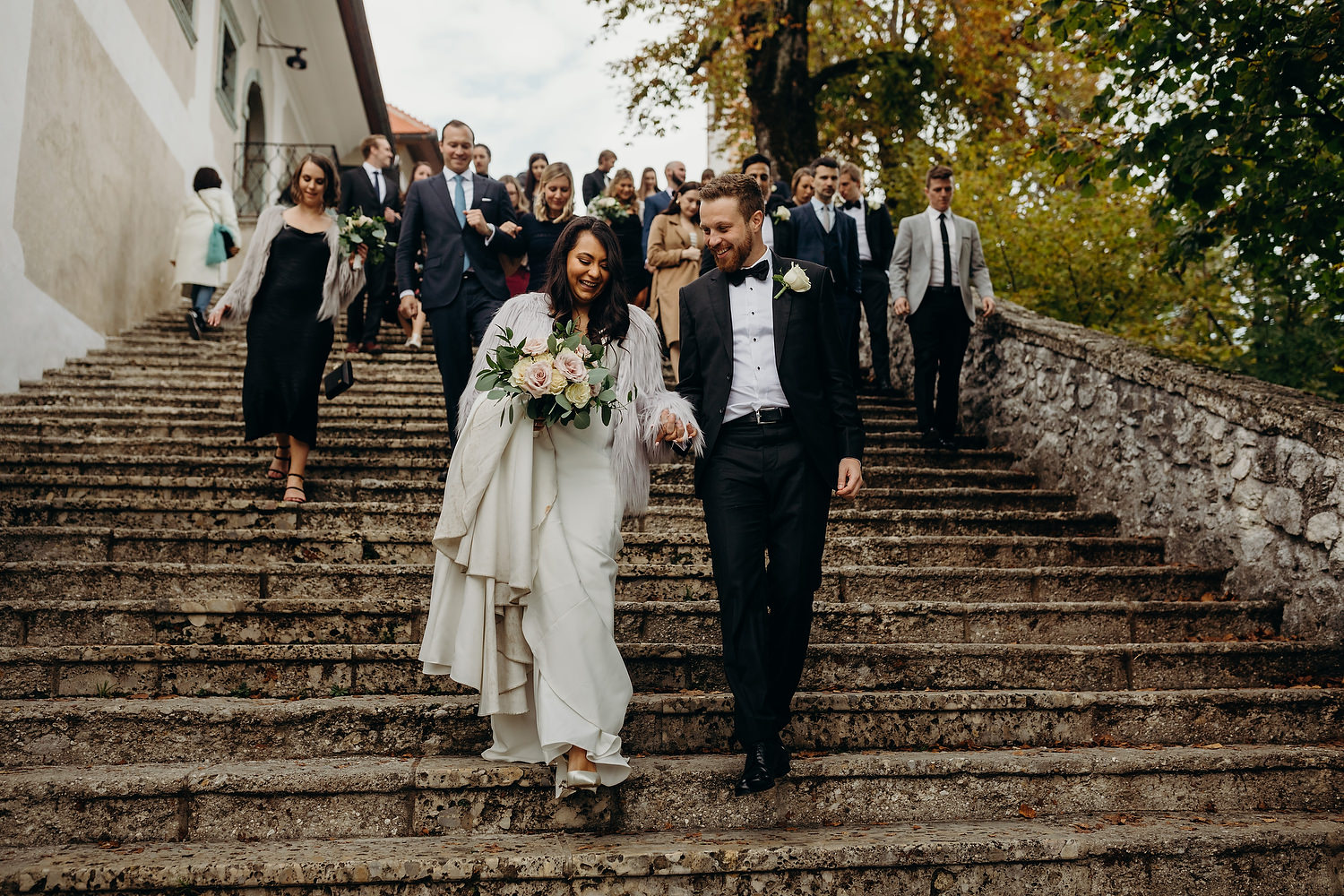couple walk down steps of Bled Island