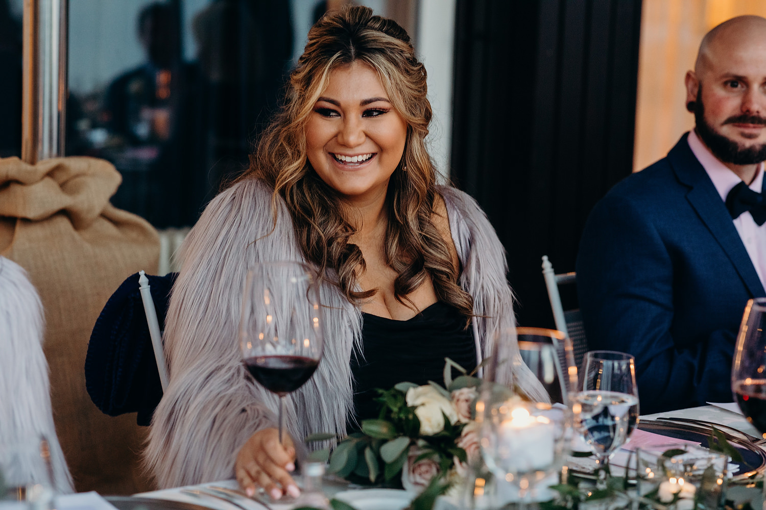bridesmaid smiling at wedding table