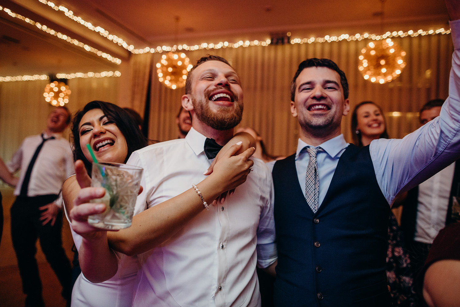 guests singing along at wedding