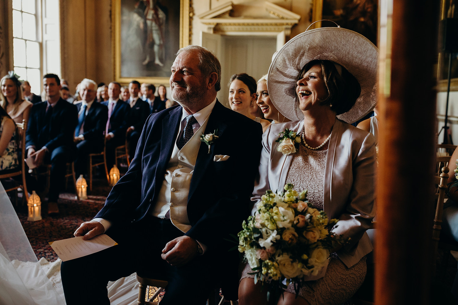 parents of bride smiling during ceremony