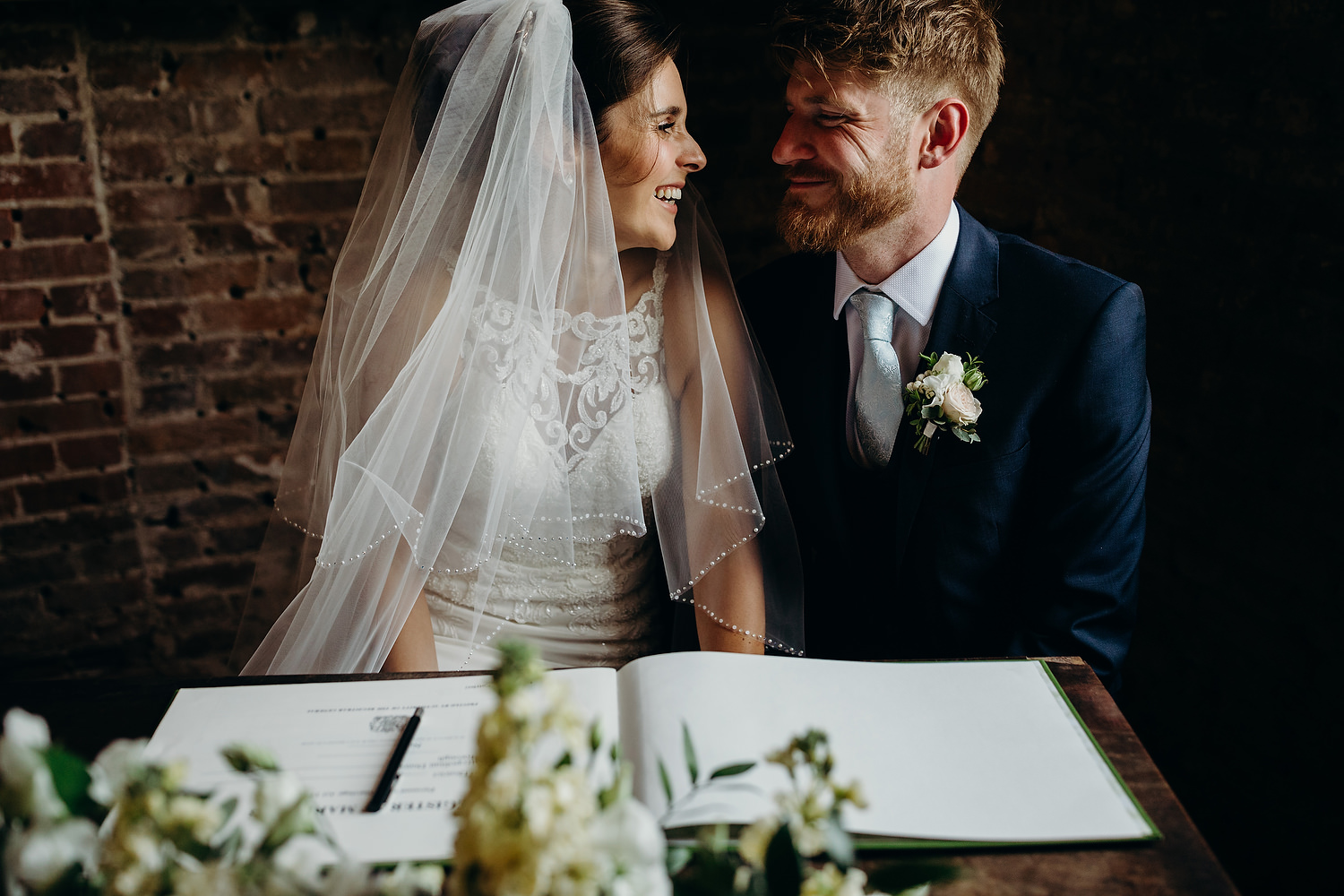 bride and groom smiling after just getting married