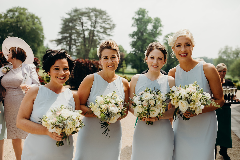 Bridesmaids smiling at camera