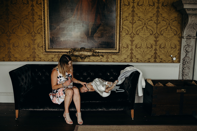 girl sleeps on sofa at wedding