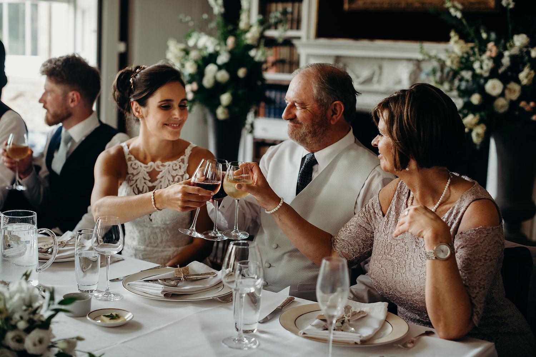 bride cheers with parents