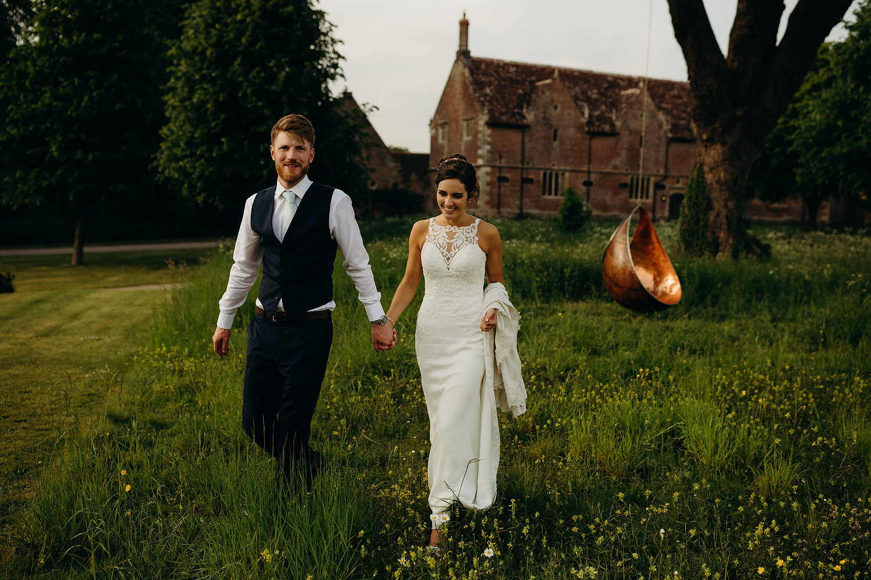 Couple walk through field