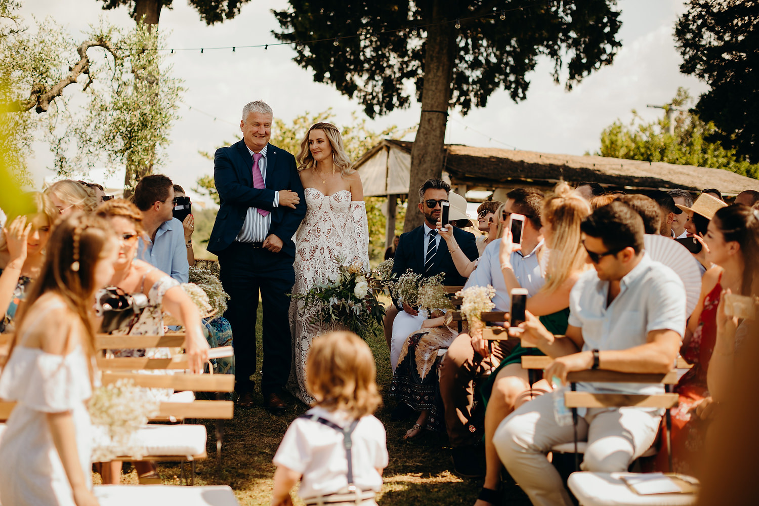 bride arrive to outdoor Tuscan ceremony