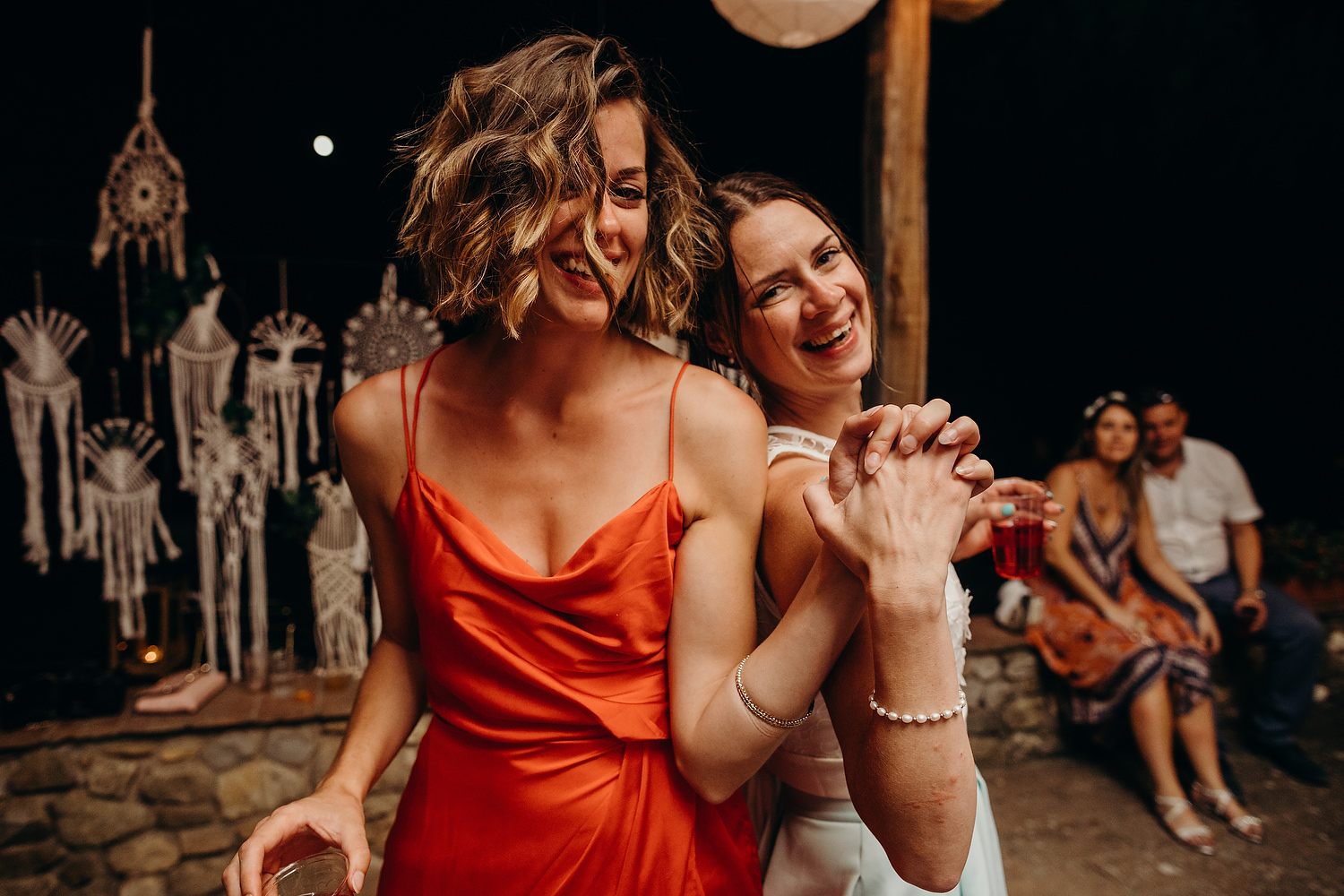 two woman dancing at wedding